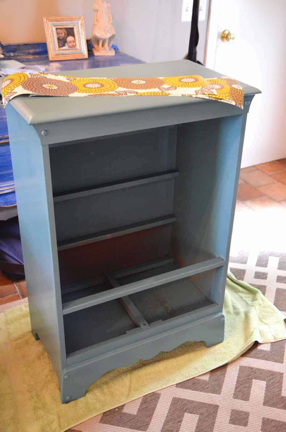 Turning a Craigslist dresser into kids dress-up storage.