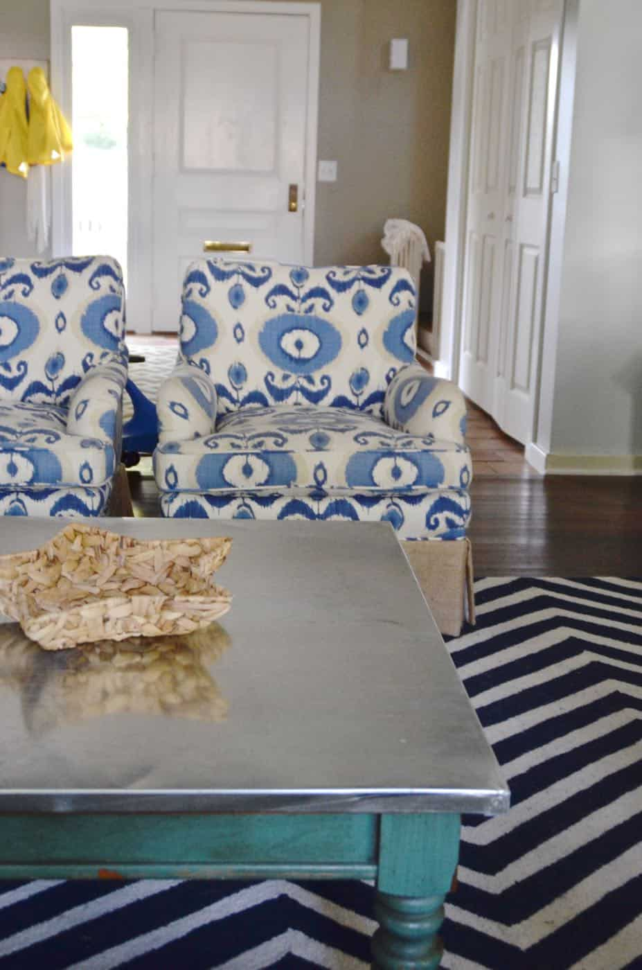 Adding an inexpensive stainless steel looking topper to any coffee table.