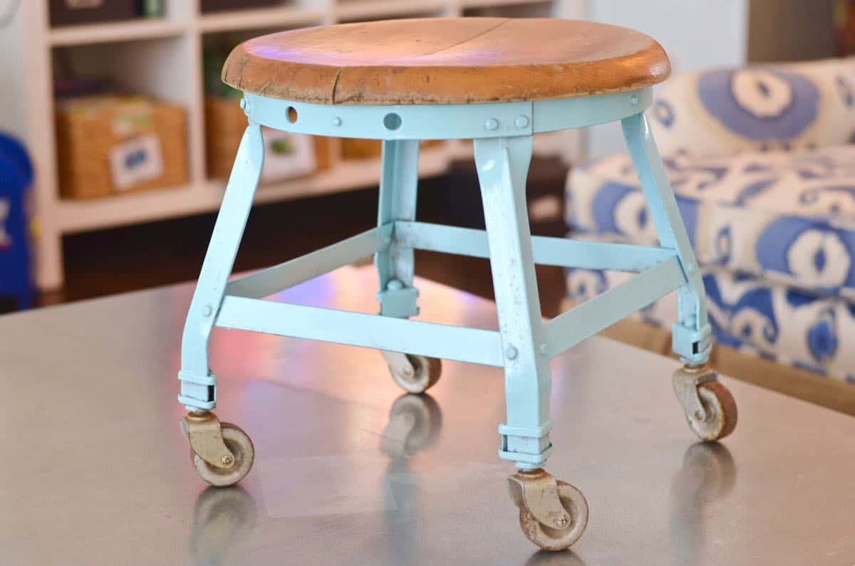 this old metal industrial stool got a makeover with a fresh coat of paint.