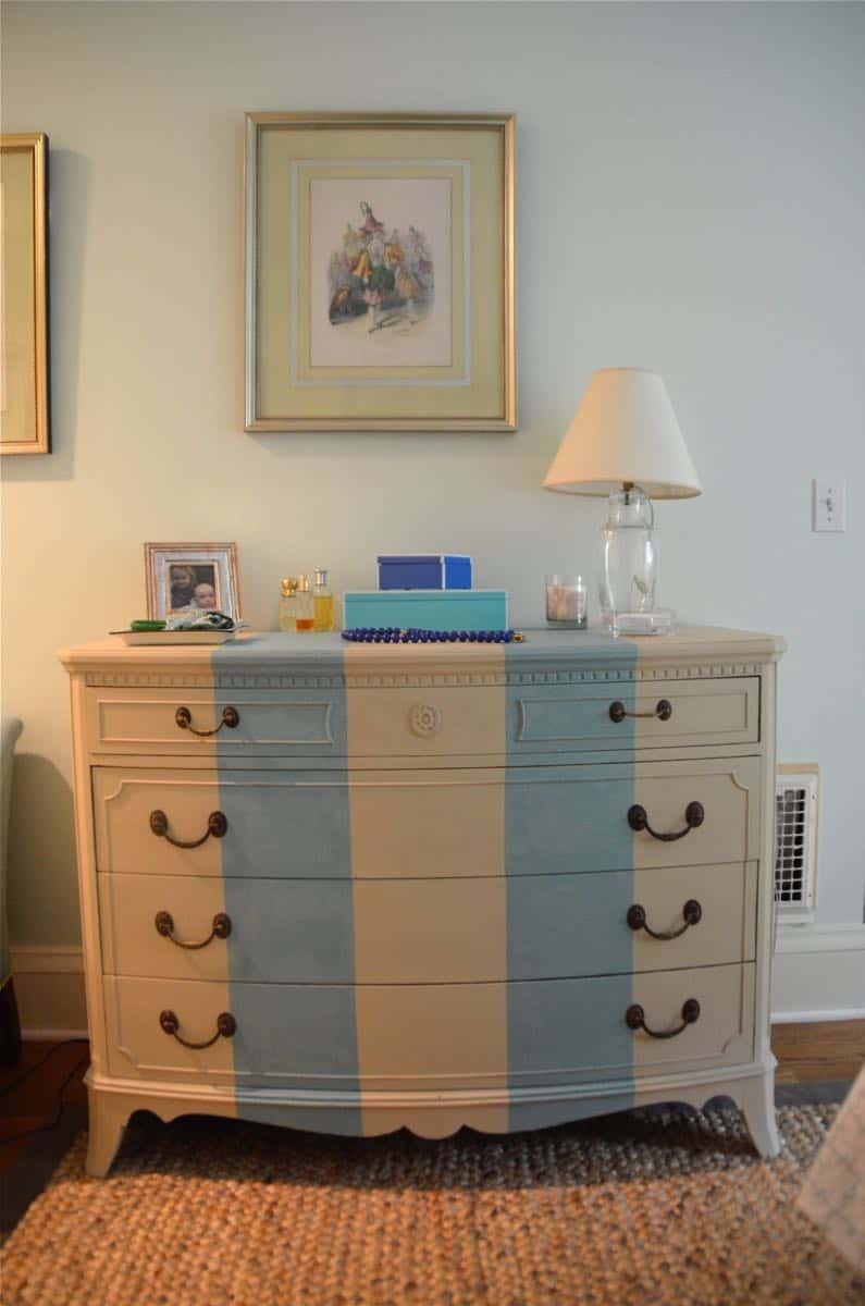Old bureau gets a fresh look and is now a colorful striped dresser for the master bedroom.