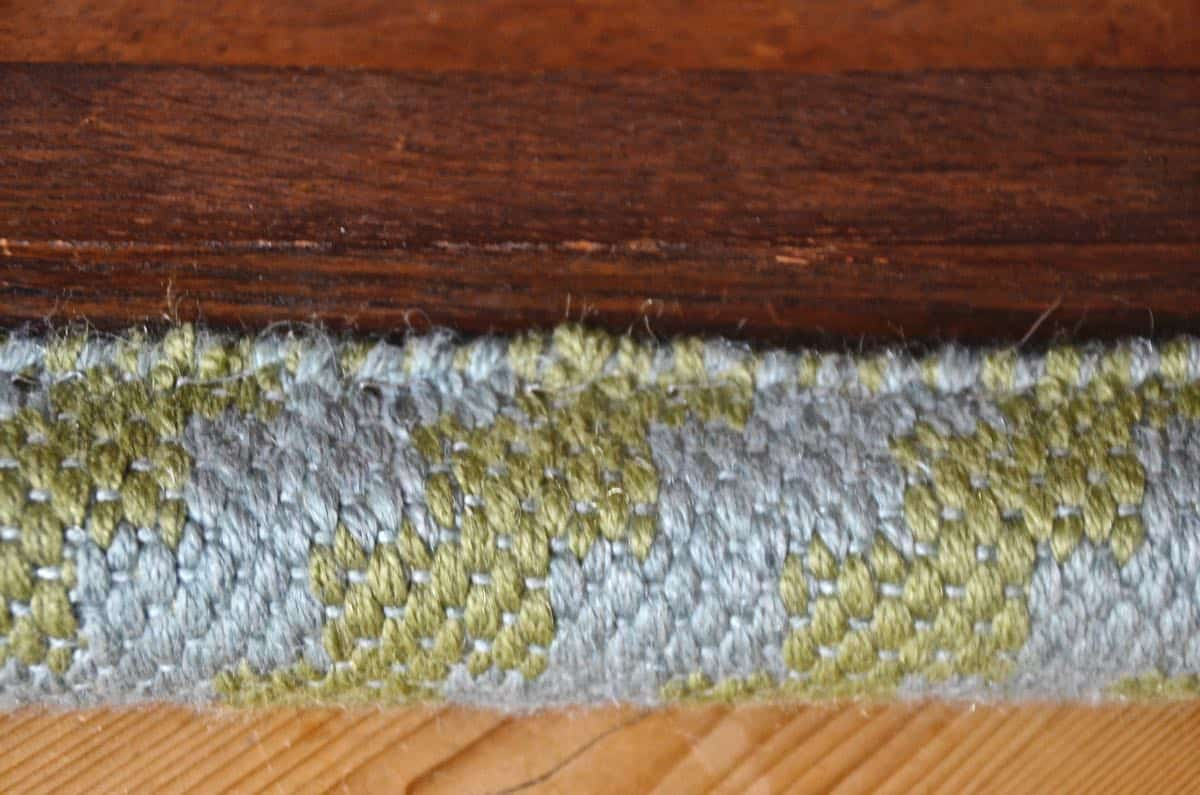 Upholstering a plain bench with a throw rug.