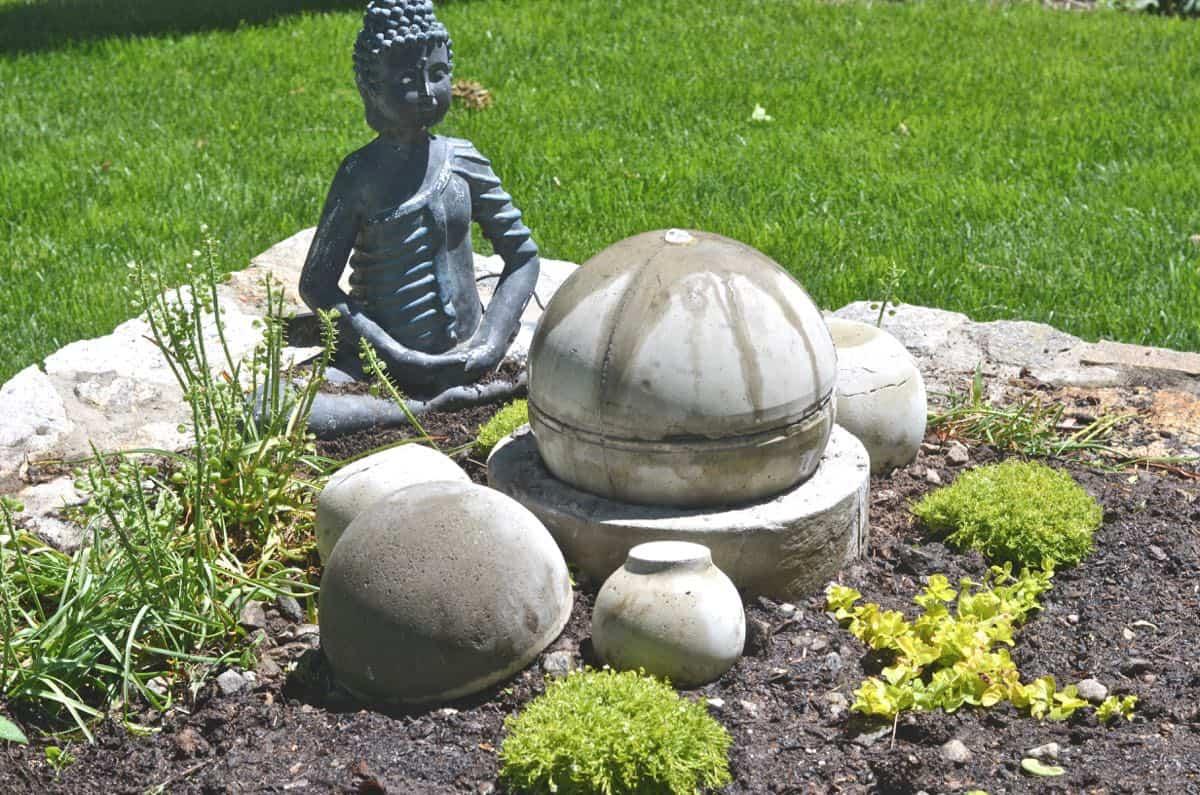 Make a bubbling concrete orb backyard fountain.