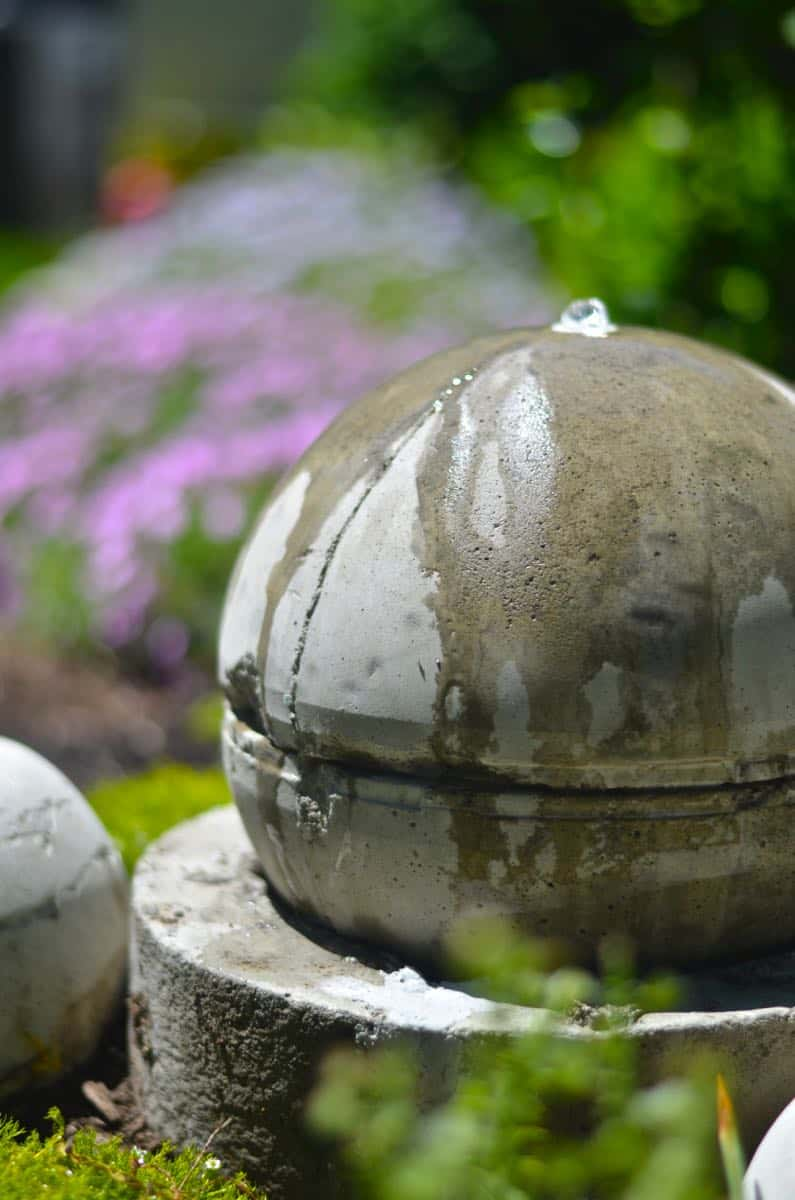 Make a bubbling concrete orb backyard fountain.