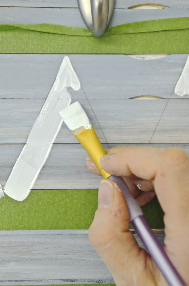 Reuse those free painters mixing sticks and give a boring piece of laminate furniture a total makeover.