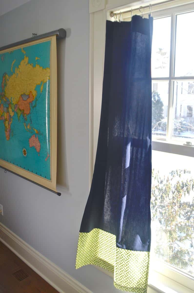 Mixing pattern and flea market treasures in our navy blue guest room.