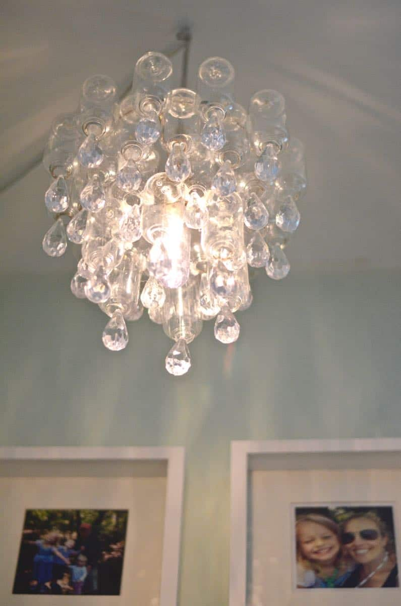 These plastic dollar store bottles were transformed into a fun and decorative chandelier