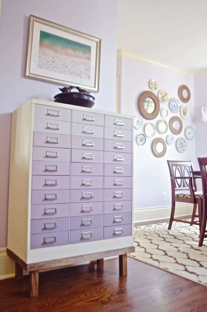 A plain industrial file cabinet is transformed thanks to an ombre paint treatment and a new DIY base.