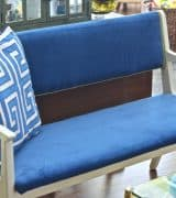 Turn a wooden bench into an upholstered loveseat.