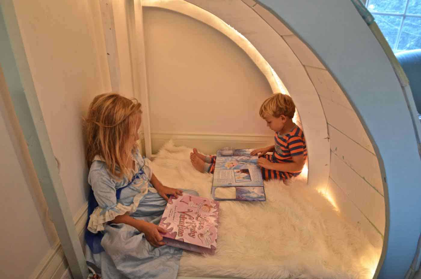 Simple and inexpensive corner reading nook using plywood and paint.