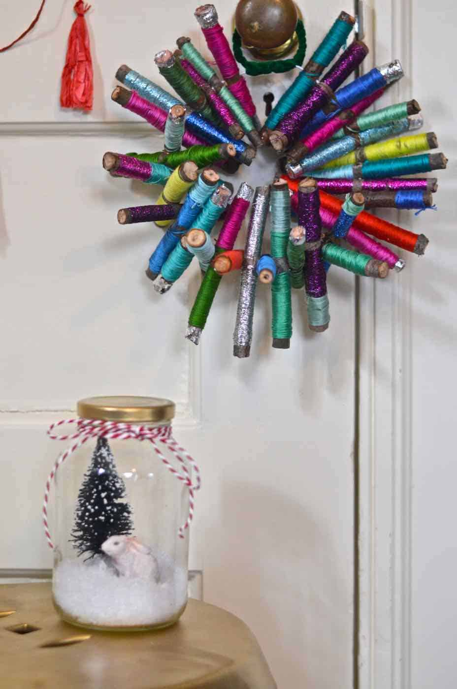 Sticks and thread transformed into this colorful rustic wreath.