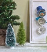 Transform thrifted glass doorknobs into repurposed Christmas snowman.