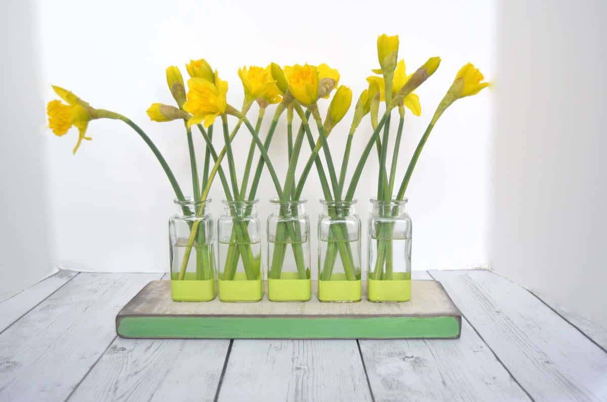 Thrift store glassware is made into this cute bud vase centerpiece.