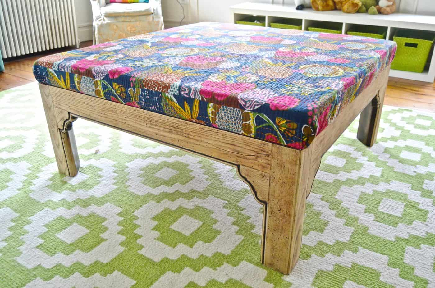 Turn a basic coffee table into an upholstered ottoman.