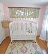 Boho bright and cheerful nursery with thrift market and boho details.