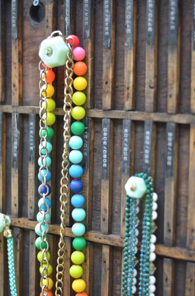 Decorative knobs turned into simple and chic jewelry storage.