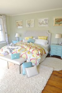 bed with bright linens