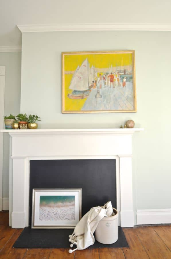 fireplace with colorful painting