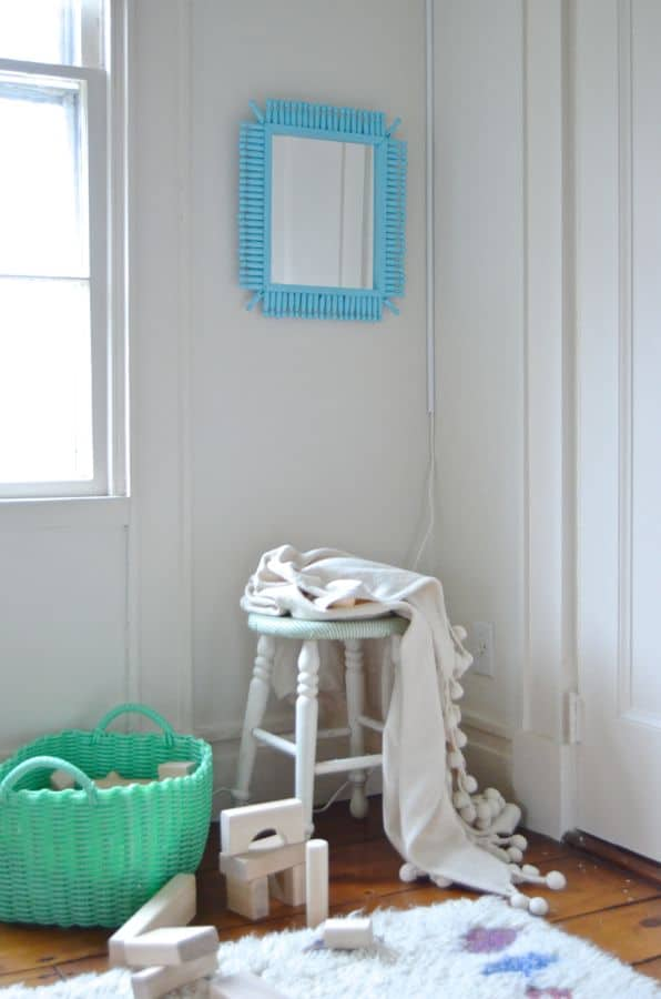 mirror hanging over stool