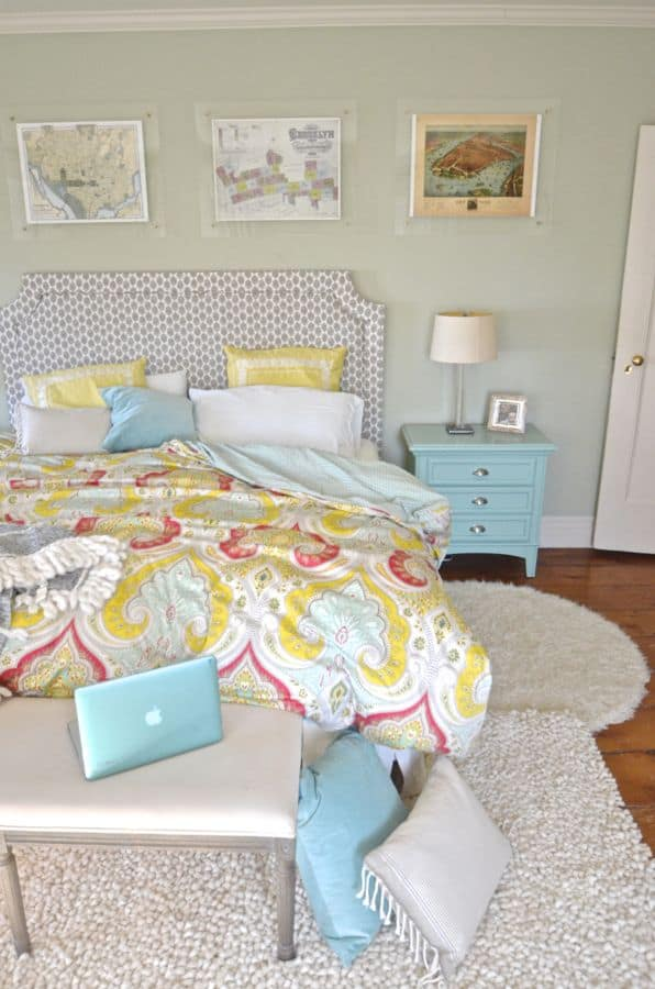pops of teal in master bedroom