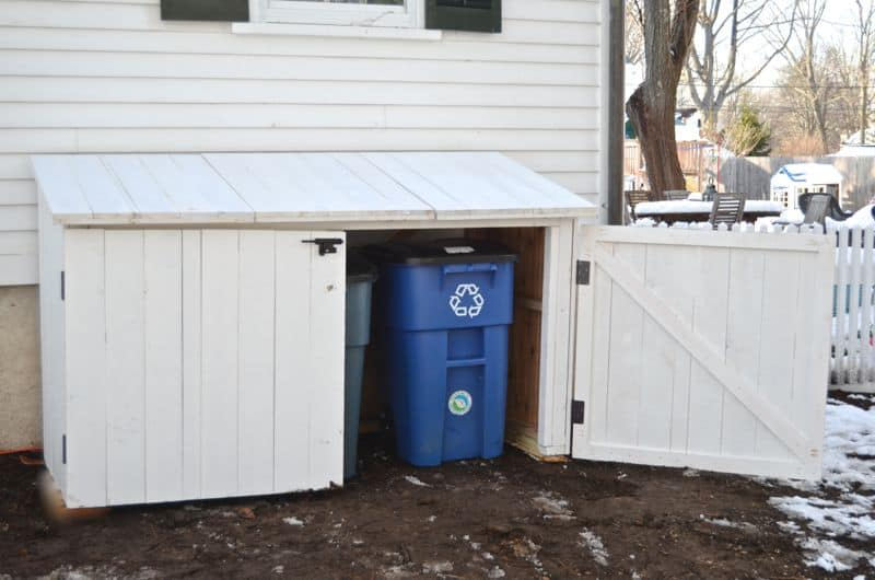 Garbage shed with door open