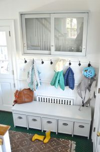 coats hanging in mudroom