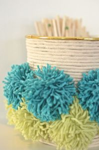 pom poms on wrapped container