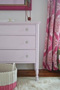 side view of pink dresser