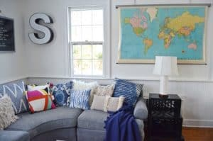 vintage map and sectional in family room