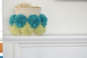 wrapped container with pom poms