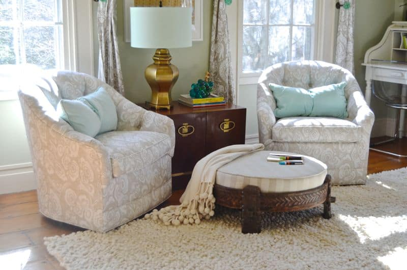 Pair of chairs with ottoman