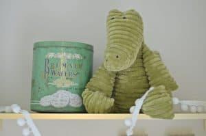 alligator and vintage tin