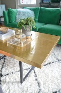 brass contact paper on table