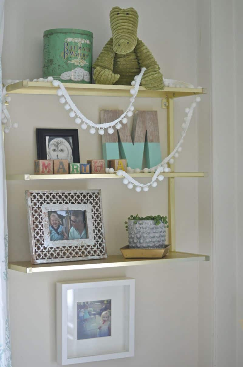 gold shelf above martha's desk