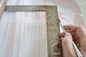 ruler and exacto to cut contact paper
