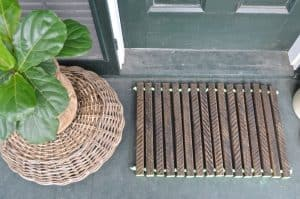 wooden doormat with fern