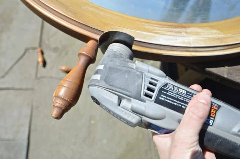 cutting off spindles of nautical mirror