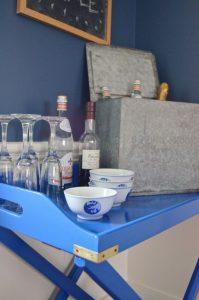 blue bar cart with brass details