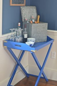 blue bar cart with dishes
