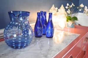 blue glassware on sideboard