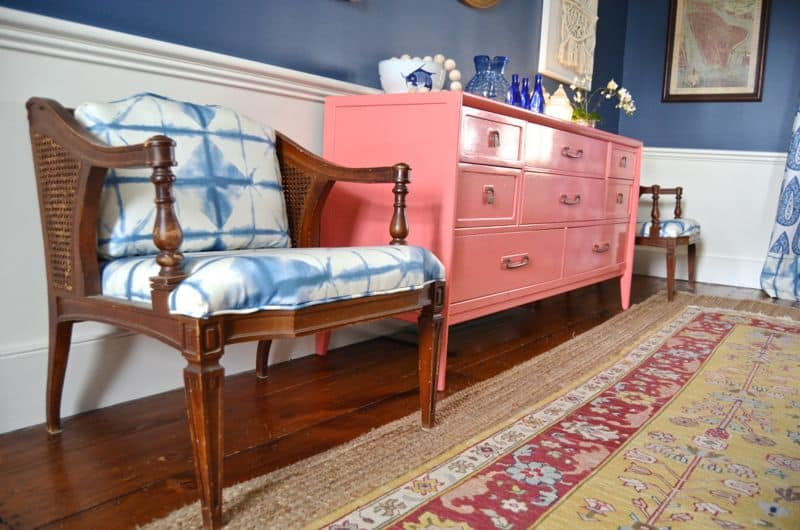 coral sideboard with layered rugs