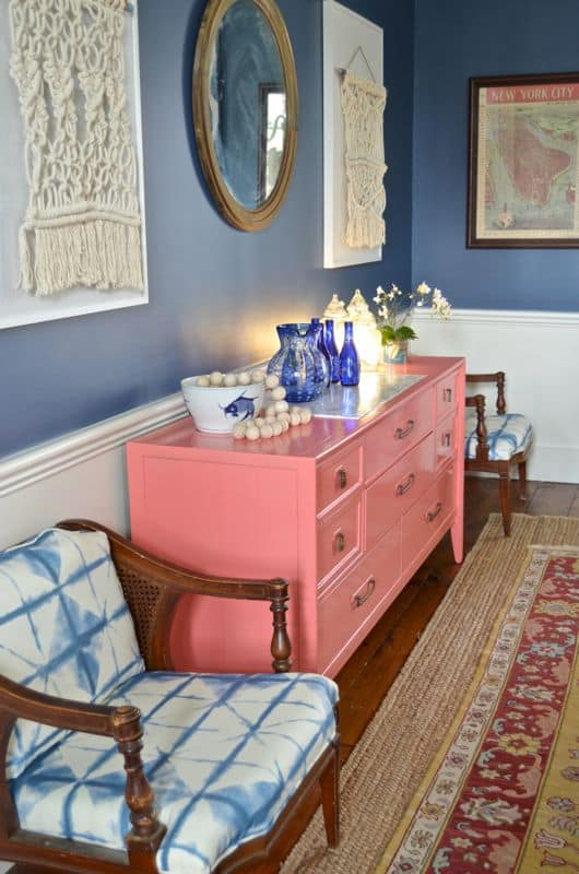 coral sideboard with tie dye fabric chairs