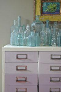 file cabinet with glass bottles