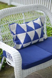 loveseat with geometric throw pillow