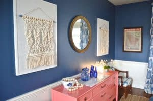 macrame wall hangings over sideboard