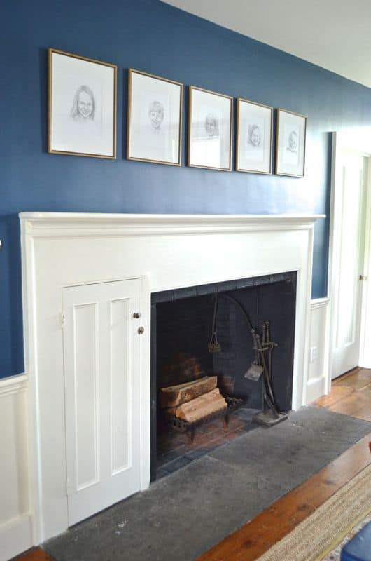 pencil portraits over fireplace