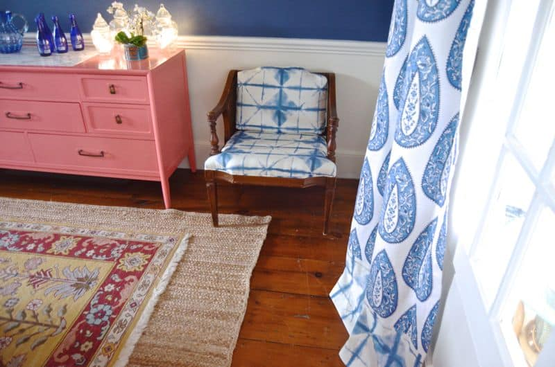 tie dye chair with coral sideboard