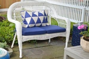 white wicker with navy cushion