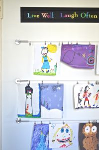 http://www.ehow.com/how_12343219_easytomake-home-gallery-display-kids-art.html