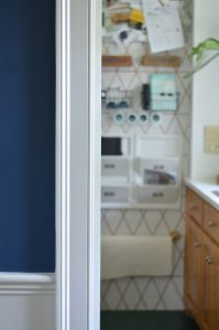 Fun kitchen command center with repurposed storage and graphic paint detail.