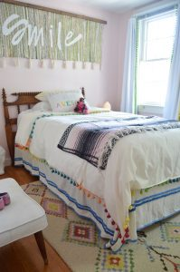 bed with pompom duvet